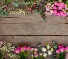 Frame Of Flowers On Rustic Woo...