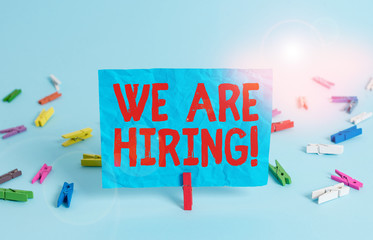 Writing note showing We Are Hiring. Business concept for recently you employ someone or pay someone to do particular job Colored clothespin rectangle square shaped paper light blue background
