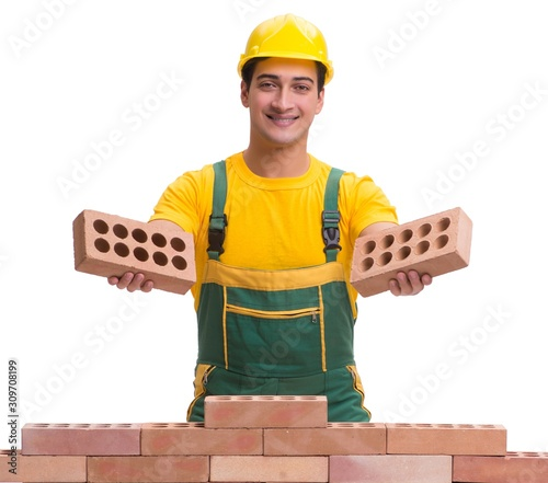 Cuadros en Lienzo The handsome construction worker building brick wall