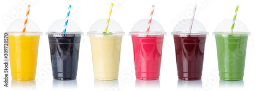 Photo Set of fruit smoothies fruits orange juice straw drink in cups isolated on white