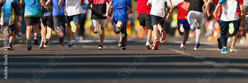 Running children, young athletes run in a kids run race,running on city road det Canvas Print