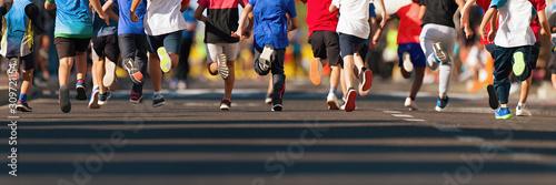 Fényképezés Running children, young athletes run in a kids run race,running on city road det
