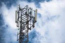 Communication Transmitter Tower With Antenna Such A Mobile Phone Tower, Cellphone Tower, Phone Pole Etc On The Clear Blue Sky Background With Copy Space For Text, Today Wide Area Technoloygy Concept.