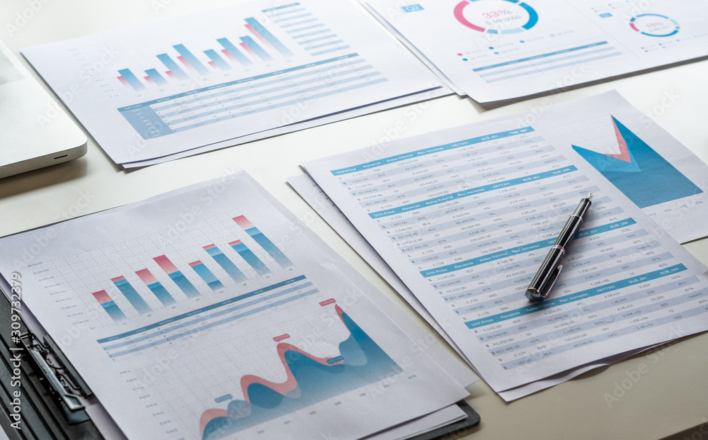 Fototapeta businessman working calculate data document graph chart report marketing research development  planning management strategy analysis financial accounting. Business office concept.