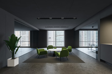 Waiting room with green armchairs in gray office