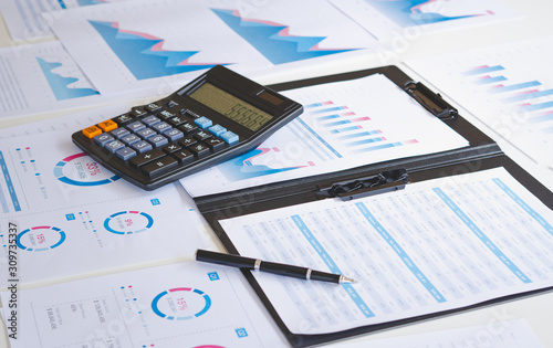 Fototapeta businessman working calculate data document graph chart report marketing research development  planning management strategy analysis financial accounting. Business office concept. obraz