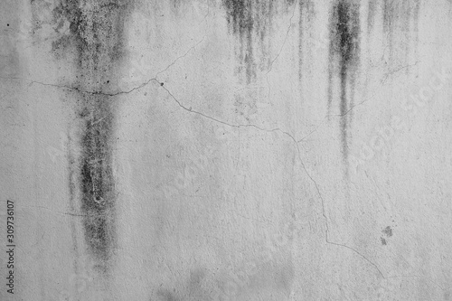 Close-up of White cement crack wall and peeled paint caused by water and sunlight Canvas-taulu