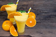 Orange juice fruit smoothies yogurt drink yellow healthy delicious taste in a glass slush for weight loss on wooden background.