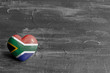 canvas print picture - South African flag on a heart on a rustic background