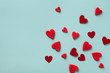 Leinwandbild Motiv Valentine day greeting card or banner. Red hearts on blue background top view. Flat lay.