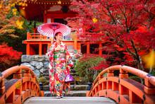 Japanese Girl In Kimono Traditional Dress Walk In Red Bridge