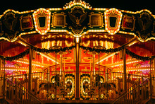 Partial View Of Beautiful Carousel With Many Light At Night In Theme Park