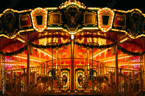 Fotografie, Obraz partial view of beautiful carousel with many light at night in theme park