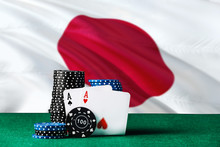 Japan Casino Theme. Two Ace In Poker Game, Cards And Black Chips On Green Table With National Flag Background. Gambling And Betting.