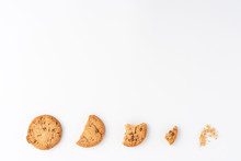 Sequence Of Chocolate Chip Cookies Being Devoured Isolated On White Background With Copyspace. Top View. Banner
