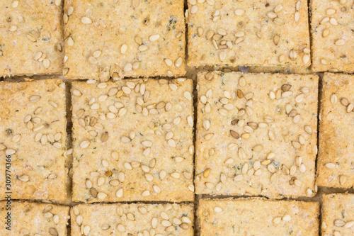 background of crispy spelt and chickpea cracker with sesame Tapéta, Fotótapéta