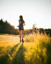 Young Sporty Woman Running Early Morning In The Beautiful Nature Forest.