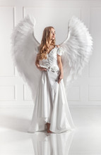 Girl In White Dress With Angel...