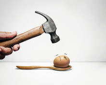 Hammer And Egg With Anxious Face