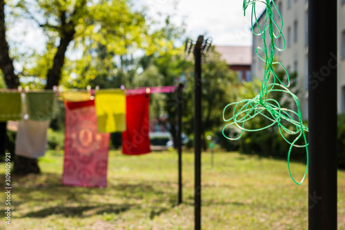 Fotomural  Clothesline with laundry that dries outdoors in the sun, Clothesline with laundr