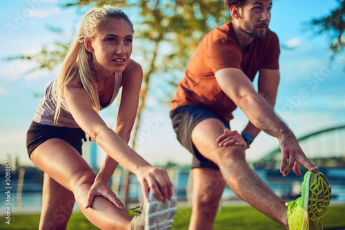 Modern couple doing exercise in urban area. Canvas Print