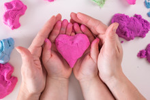 Heart In Child And Mother Hands
