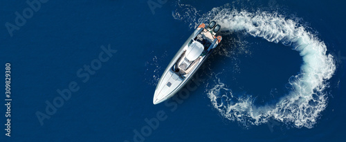 Leinwand Poster Aerial drone ultra wide top down photo of luxury rigid inflatable speed boat cru
