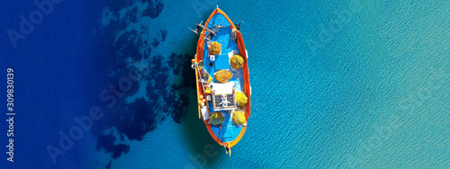 Aerial drone top down ultra wide photo of traditional fishing boat docked in wor Fototapete