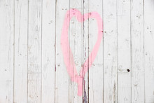 Pink Heart On White Wooden Fence. Bright Wooden Texture Background. Love, St Valentine's Day Concept. Copy Space