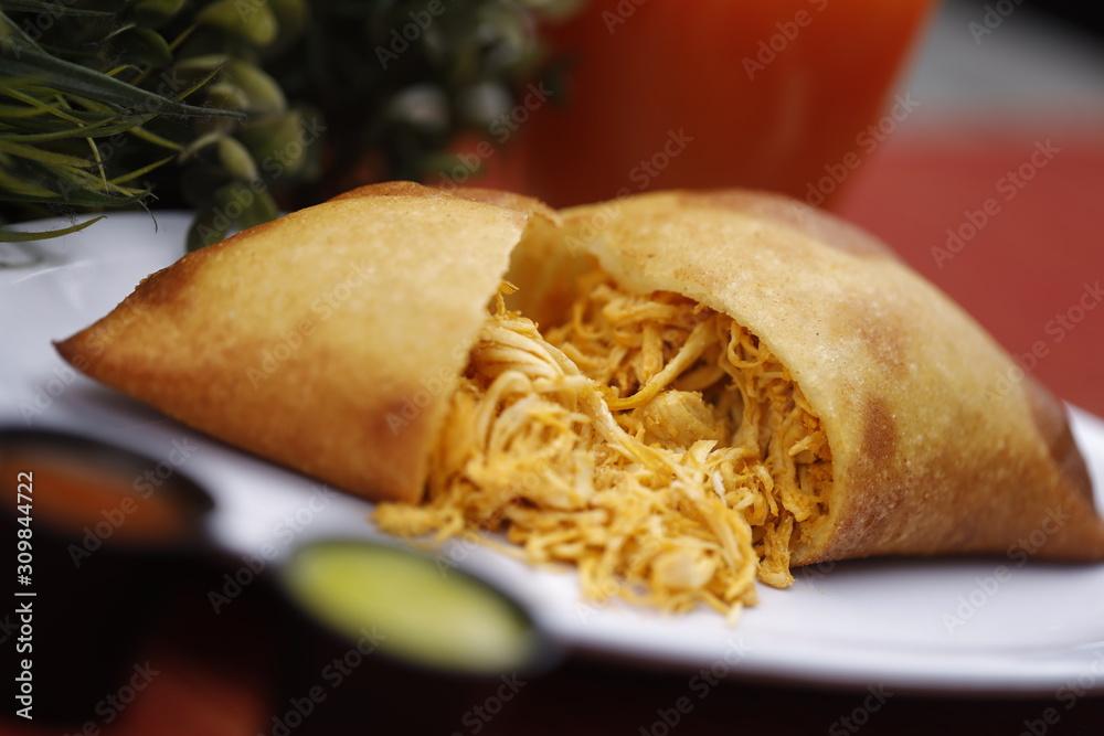 Fototapeta Empanada de Pollo, Comida tradicional Venezolana. Traditional Venezuelan Food