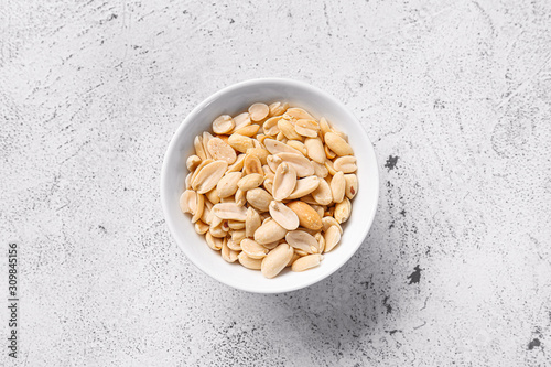 Photo Bowl with peanuts on white background