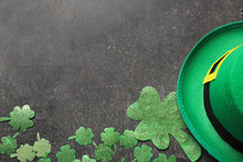 Hat Of Leprechaun With Clover On Dark Background. St. Patrick's Day Celebration