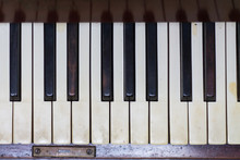Aged Piano With Dirty Keys And Reflections