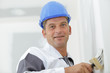 portrait of a tradesman using a wallpapering brush