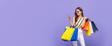 Beautiful Asian Woman Carrying Colorful Bags Shopping Online With Mobile Phone