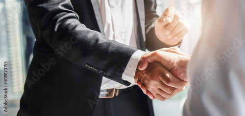 Valokuvatapetti business background of businessman having handshake