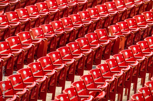 Rows of red outdoor theater seats.