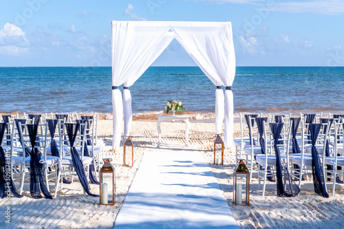 Blue themed wedding setup at the white sandy beach Wallpaper Mural