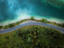 Beautiful Aerial View Of Road Between Green Summer Forest And Blue Lake In Austria,Europe,Plansee Lake.