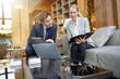 Leinwanddruck Bild - Business people meeting in hotel lounge