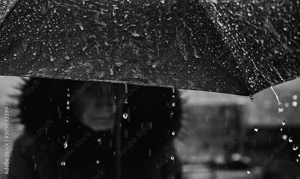 Fototapeta woman with umbrella in the rain