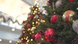 4k shining Christmas tree in the building, building on Christmas Eve Bright bokeh, blurred background