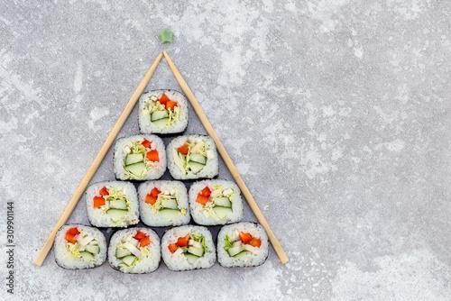 Fototapeta sushi christmas tree on grey background obraz