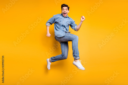 Obraz Turned full length body size photo of cheerful positive crazy man urgent for sales and discount in white sneakers denim isolated vivid color background - fototapety do salonu