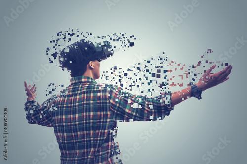 Fotografía Asian man open arm happy in tartan shirt wearing glasses of virtual reality diss