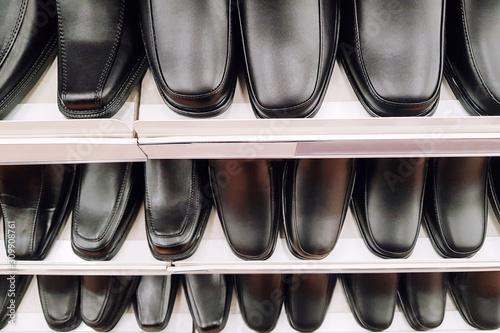 More black shoes on shelves Canvas Print