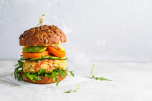 Vegan Burger With Vegetable Cutlet, Sweet Potato, Avocado, Cucumber And Arugula, Copy Space. Healthy Plant Based Food Concept.
