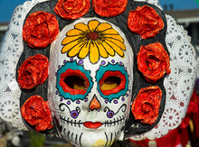 Painted Human Skull With Flowers For Mexico's Day Of The Dead