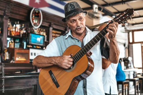 Havana, Cuba - October 18, 2019: Cuban band performing live music in a bar (Dos Hermanos) in Havana, Cuba Wallpaper Mural