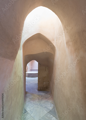 Fotomural  Aged narrow dark stone vaulted passage at ottoman era public Turkish historical